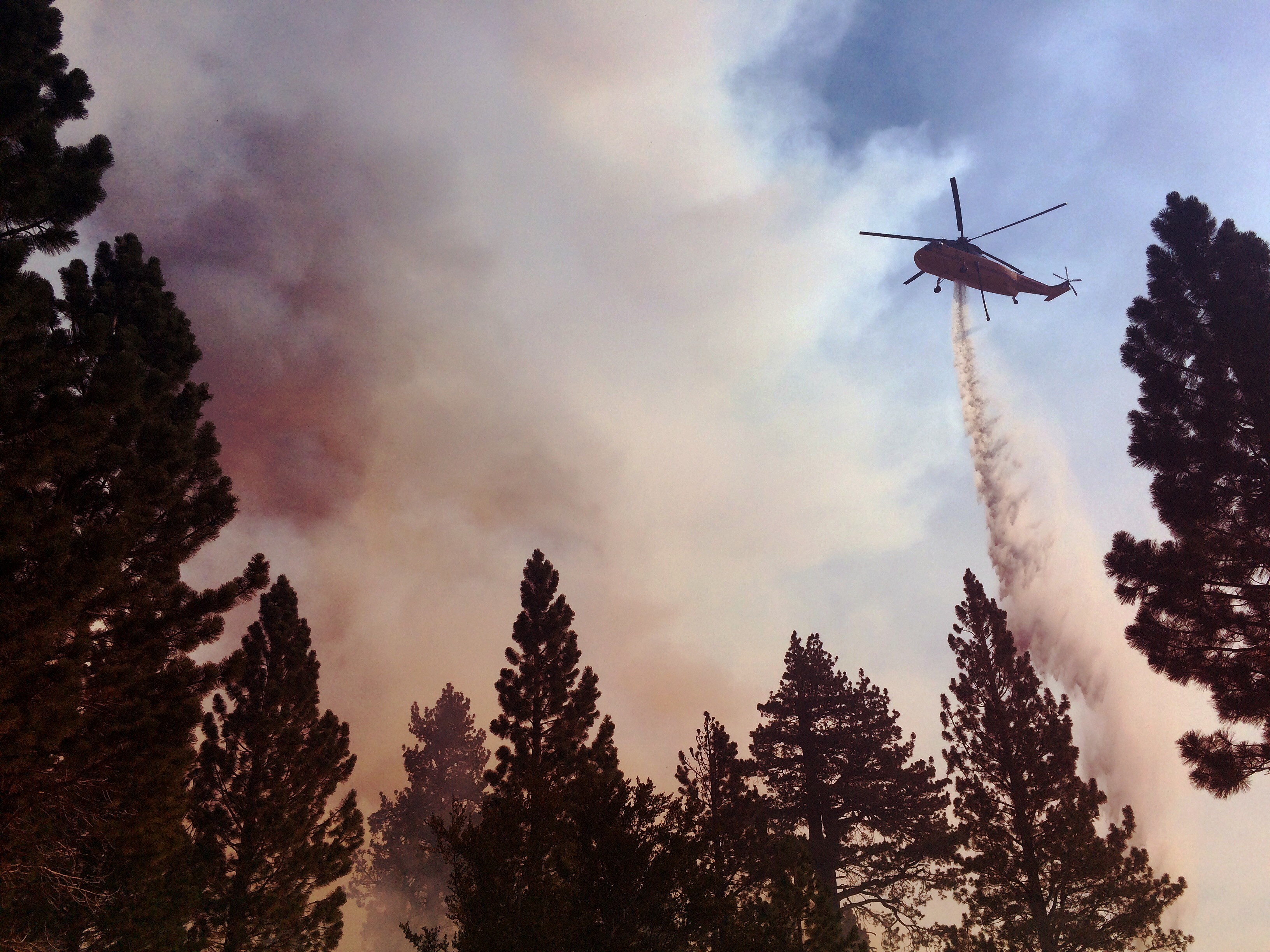 Helicopter fighting wildland fire from the air. Photo taken by ExpertVoice Expert Gregg Boydston.