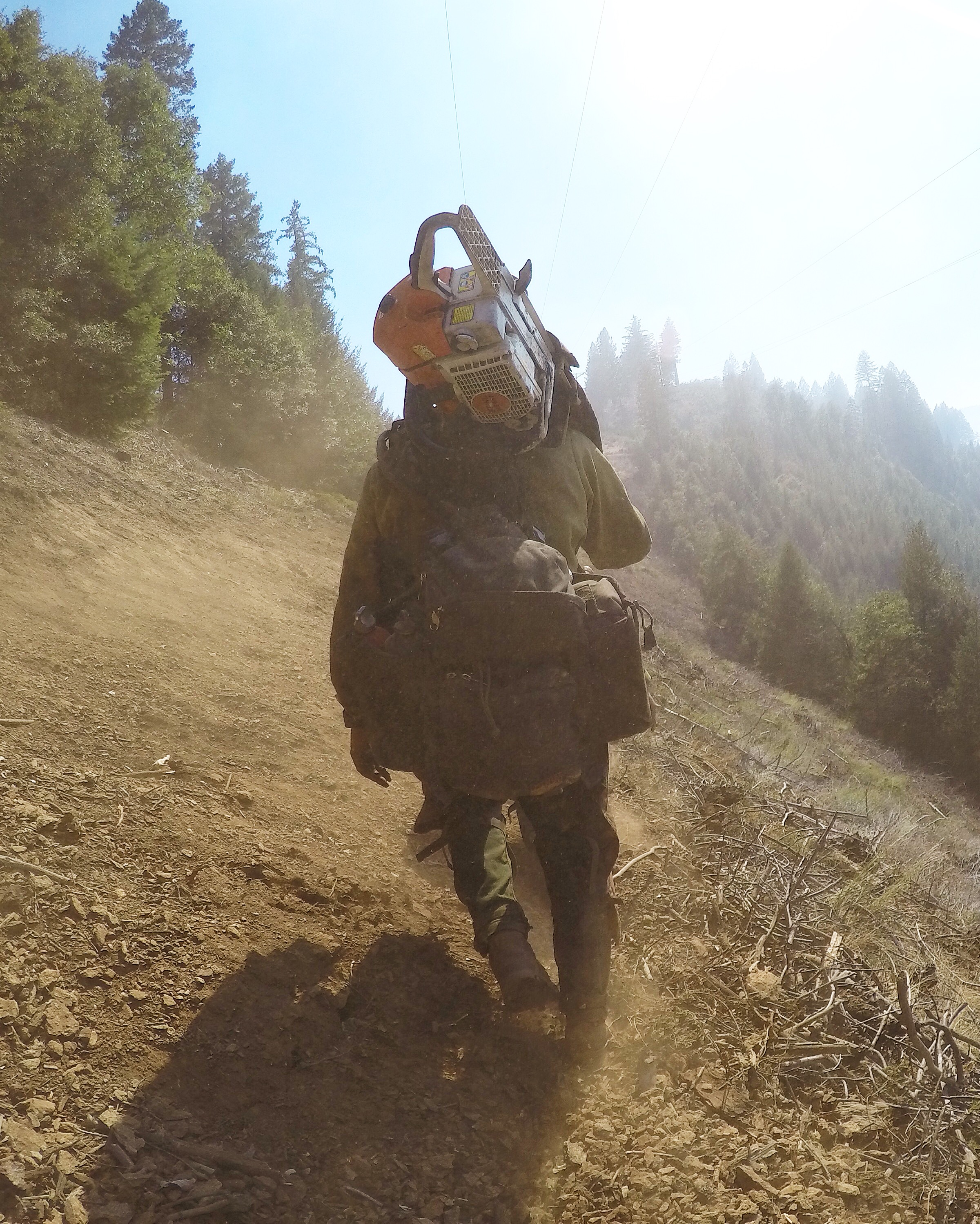 Wildland firefighter carrying chainsaw from taken by ExpertVoice Expert Gregg Boydston