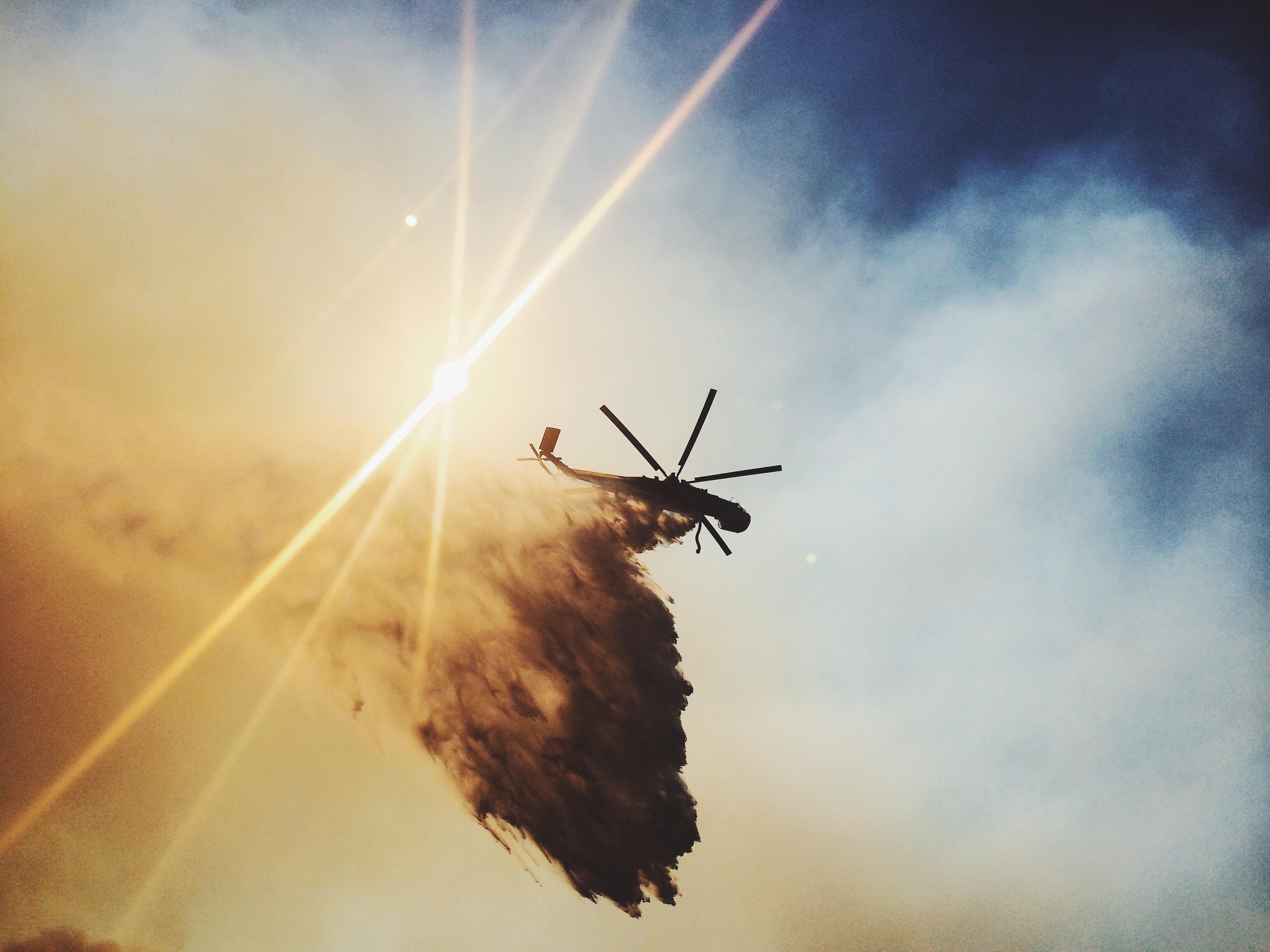 Helicopter fighting wildland fire. Photo taken by ExpertVoice Expert Gregg Boydston.
